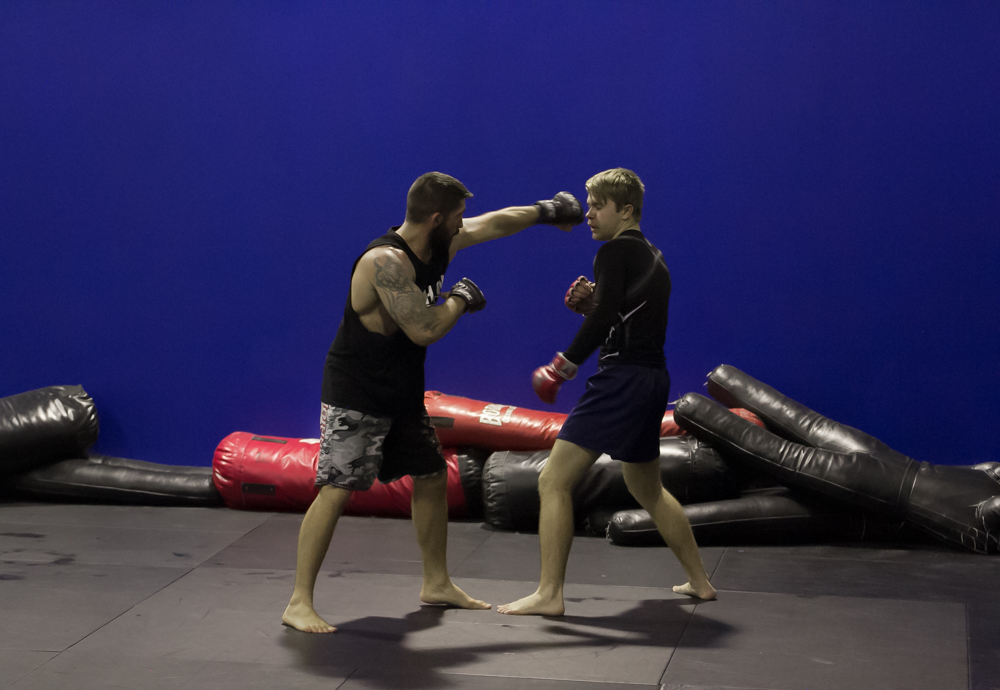 People Practicing Boxing Technique